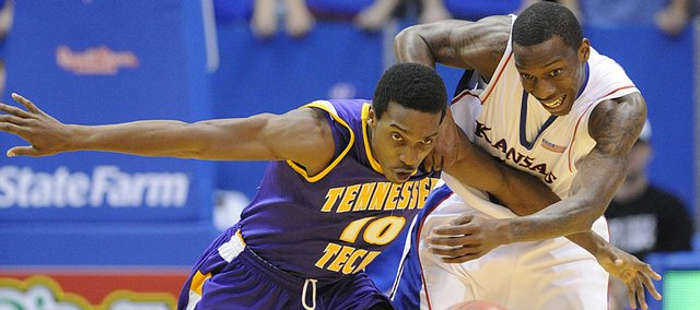 KU guard Tyshawn Taylor and Tennessee Tech's Elijah Muhammad go for a loose ball Friday, Nov. 27, 2009 at Allen Fieldhouse.