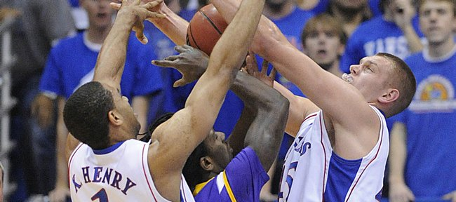 KU guard Xavier Henry and center Cole Aldrich pressure Tennessee Tech's Kevin Murphy Friday, Nov. 27, 2009 at Allen Fieldhouse.