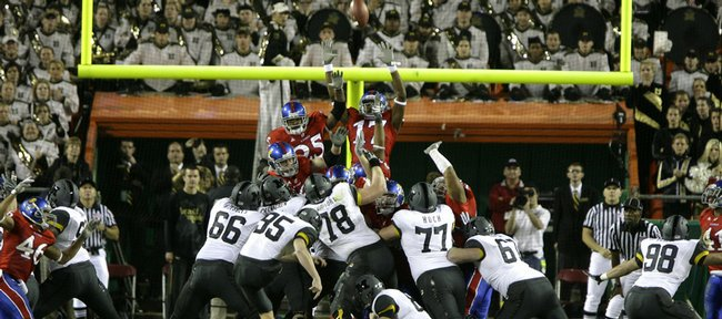 A field goal by Missouri kicker Grant Ressel clears the Jayhawks' defense to win the game for the Tigers, 41-39, as time expires, Saturday, Nov. 28, 2009 at Arrowhead Stadium.