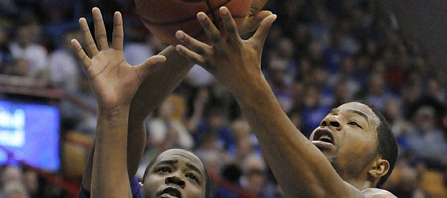 KU center Markieff Morris pulls down a rebound against Tennessee Tech's Alfred Jones Friday, Nov. 27, 2009 at Allen Fieldhouse.