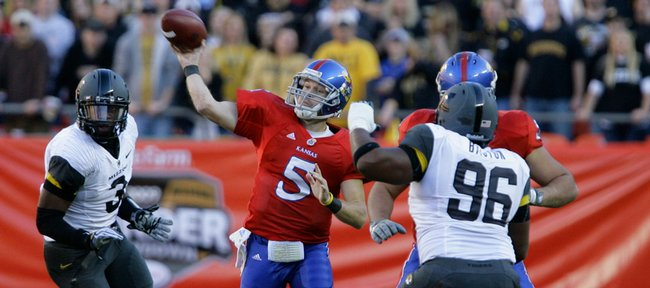 Kansas quarterback Todd Reesing heaves a pass over the Missouri defense during the first quarter, Saturday, Nov. 28, 2009 at Arrowhead Stadium.