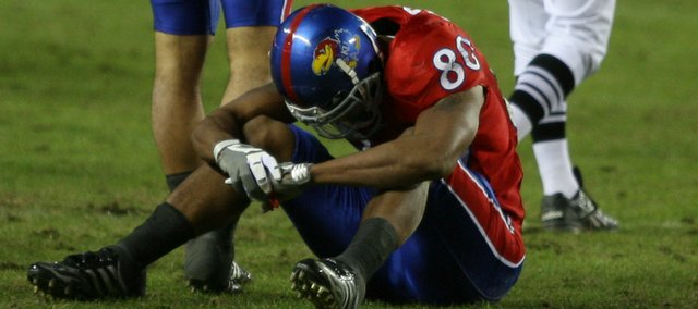 Kansas receiver Dezmon Briscoe (80) laments his second fumble of the game against Missouri during the third quarter, Saturday, Nov. 28, 2009 at Arrowhead Stadium.
