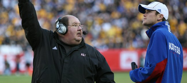 Kansas head coach Mark Mangino looks up to the booth during the second quarter, Saturday, Nov. 28, 2009, at Arrowhead Stadium.