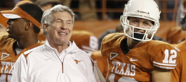 Texas quarterback Colt McCoy, right, celebrates a victory with head coach Mack Brown near the end of a 51-20 win against Kansas, Saturday, Nov. 21, 2009, in Austin.