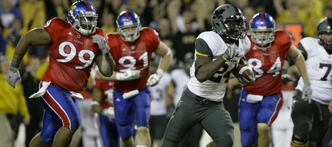 Missouri tailback Derrick Washington breaks past the Kansas defense late in the fourth quarter, Saturday, Nov. 28, 2009 at Arrowhead Stadium.