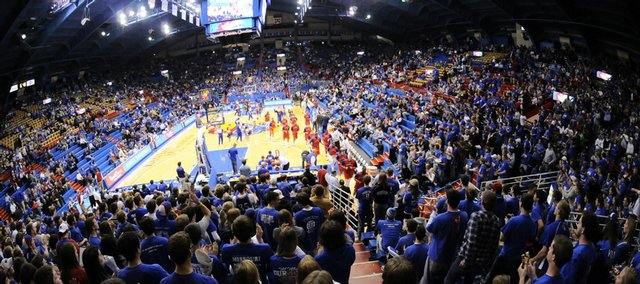 Kansas fans come to their feet in the north end zone as the Jayhawks leave the court Wednesday following warmups in preparation for tipoff against Alcorn State at Allen Fieldhouse. Kansas Athletics Inc. is discounting seats normally reserved for students at $10 a seat.