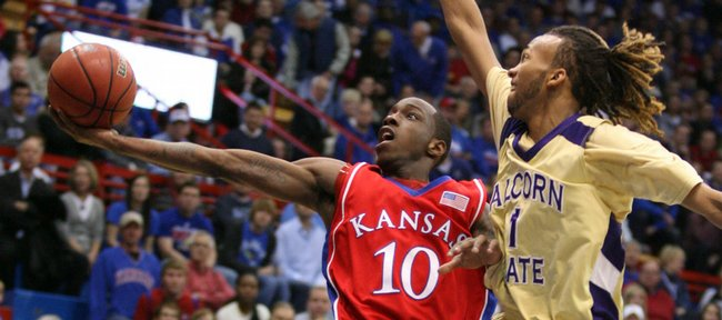Kansas guard Tyshawn Taylor extends to the bucket as he is fouled by Alcorn State guard Keith Searcy during the first half, Wednesday, Dec. 2, 2009 at Allen Fieldhouse.