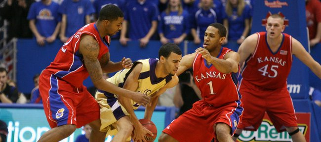 Kansas players Marcus Morris and Xavier Henry close in on Alcorn State forward Ian Francis during the first half, Wednesday, Dec. 2, 2009 at Allen Fieldhouse. At right is Kansas center Cole Aldrich.