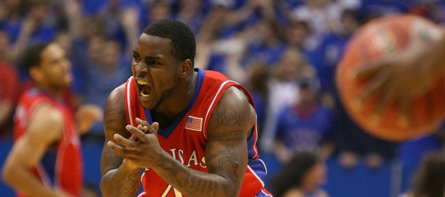 Kansas guard Sherron Collins pumps up his teammates after a slow start by the Jayhawks against Alcorn State during the first half, Wednesday, Dec. 2, 2009 at Allen Fieldhouse.