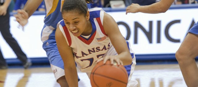 KU guard Angel Goodrich gets bumped by a UCLA defender during the Jayhawks' home victory against UCLA Thursday night, Dec. 3, 2009.