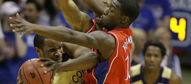Kansas guard Elijah Johnson, front, and Marcus Morris, back, look to trap Alcorn State guard Michael Martin during the first half, Wednesday, Dec. 2, 2009 at Allen Fieldhouse.