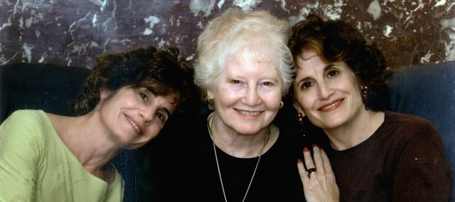 Identical twins Mary (left) and Alice Lieberman (right) pose with their mother, Sally Lieberman, in 2006.