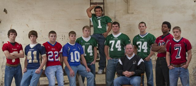 Pictured is the 2009 All-area football team. From left to right are: Jeremy Carlisle, Tonganoxie; Hogan Randall, Veritas Christian; Brandon Barnes, Oskaloosa; Brad Phillips, Perry-Lecompton; Keene Niemack, Camren Torneden, Michael Lisher, coach Bob Lisher and Kirk Resseguie, Free State High; and Boomer Mays and Evan Cleveland, Eudora.