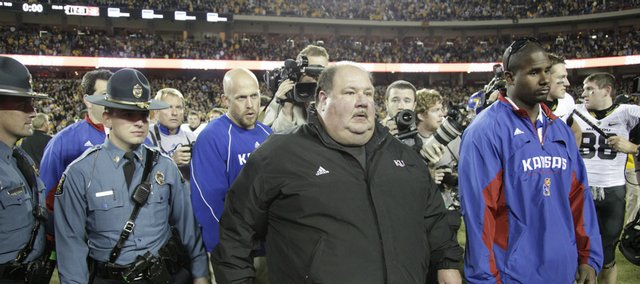 Kansas head coach Mark Mangino walks off the field following the Jayhawks&#39; 41-39 loss to Missouri, Saturday, Nov. 28, 2009 at Arrowhead Stadium.
