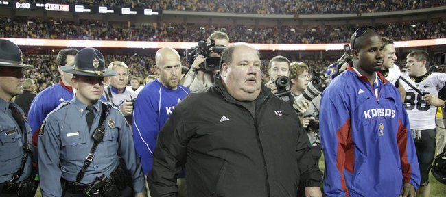 Kansas head coach Mark Mangino walks off the field following the Jayhawks' 41-39 loss to Missouri, Saturday, Nov. 28, 2009 at Arrowhead Stadium.