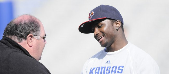 Jayhawk standout Charles Gordon talks with head coach Mark Mangino after the 2009 Spring Game Saturday, April 11, 2009 at Memorial Stadium.