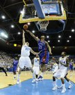 Kansas forward Markieff Morris defends a shot by UCLA guard Michael Roll during the first half, Sunday, Dec 6, 2009 at Pauley Pavilion. At right is UCLA guard Malcolm Lee.