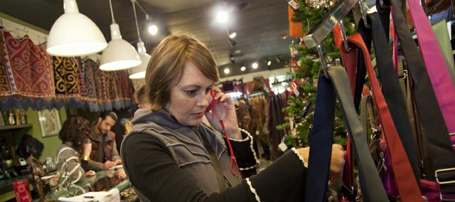 Jessica Mitchell, Lawrence, looks through a selection of bags at Nomads, 725 Mass.