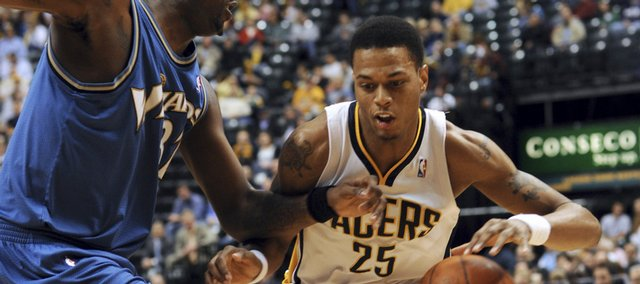 Indiana Pacers guard and former Kansas Jayhawk Brandon Rush, right, drives on Washington Wizards forward Andray Blatche during the first half of an NBA basketball game in Indianapolis on Sunday March 29, 2009. Rush scored 29 points in the Pacers' 124-115 win.