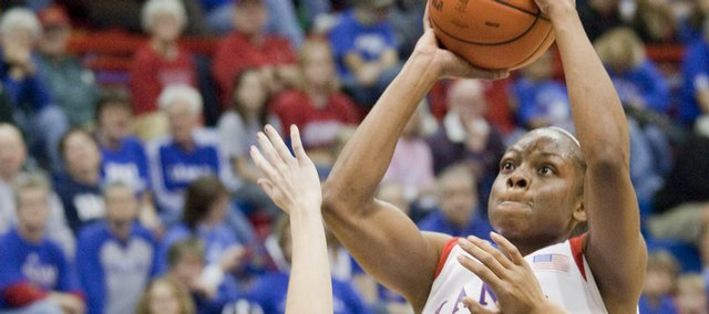 KU's Danielle McCray (4) puts up a jump shot over a screen by Aishah Sutherland (1), during the Jayhawks' game against Northern Colorado, Sunday, Dec. 6, 2009, at Allen Field House.