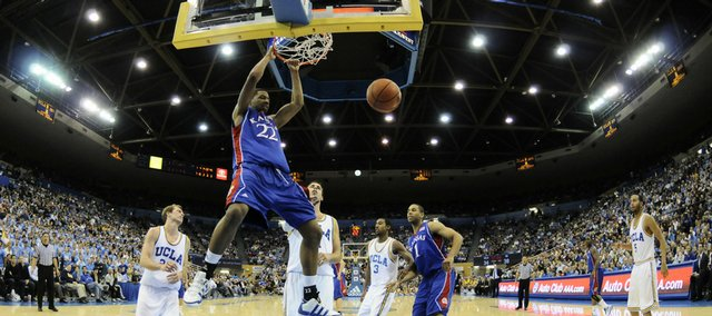 Kansas forward Marcus Morris delivers a dunk before the UCLA defense during the second half, Sunday, Dec 6, 2009 at Pauley Pavilion.