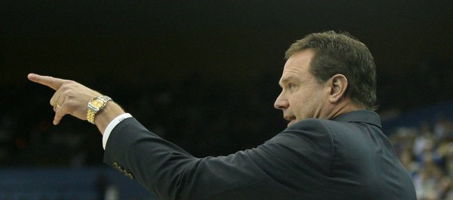 Kansas head coach Bill Self grabs the attention of his players during the second half against UCLA, Sunday, Dec. 6, 2009 at Pauley Pavilion. Self is about to embark on the recruitment trail for most of the month of July.