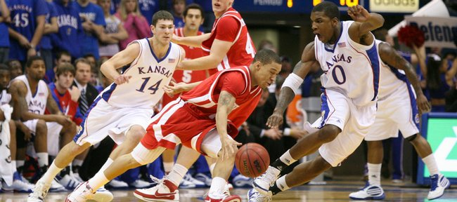 Kansas forward Thomas Robinson keeps pace with Radford guard Jeremy Robinson during the first half, Wednesday, Dec. 9, 2009 at Allen Fieldhouse.
