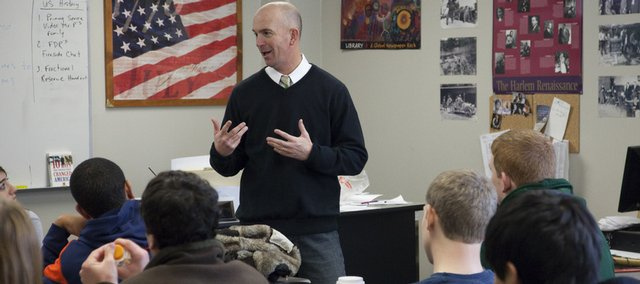 Free State teacher Jason Pendleton leads a discussion in his senior American government class Wednesday. Pendleton is leaving the Lawrence school district to work in the Blue Valley district, where he'll earn about $8,000 more for teaching and coaching, he said.