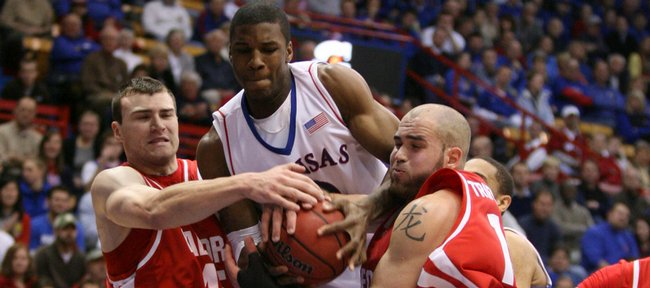 Kansas forward Thomas Robinson fights for a rebound with Radford big men Artsiom Parakhouski, left, and Lazar Trifunovic during the first half, Wednesday, Dec. 9, 2009 at Allen Fieldhouse.