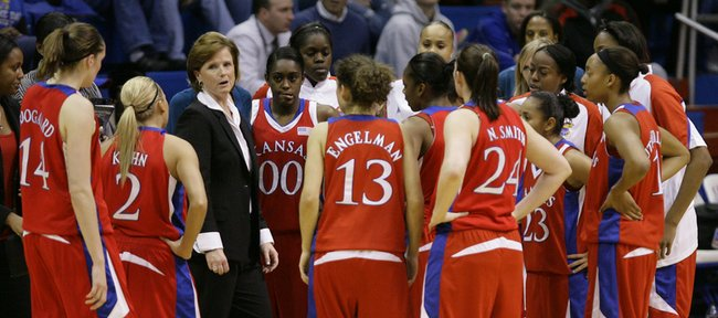 Kansas head coach Bonnie Henrickson has a talk with her team during a timeout during the first half, Thursday, Dec. 10, 2009 at Allen Fieldhouse.