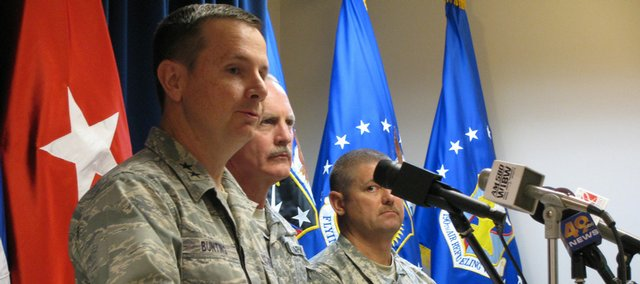 From left, Maj. Gen. Tod Bunting, Kansas adjutant general; John Davoren, assistant adjutant general, and Cmdr. Sgt. Maj. Scott Haworth on Friday announce closing of 18 of state's 56 National Guard armories. They will close due to budget cuts. The Lawrence armory will remain in use. Those to be closed in early 2010 are Atchison, Burlington, Chanute, Cherryvale, Council Grove, Fort Scott, Garden City, Garnett, Goodland, Horton, Kingman, Larned, Phillipsburg, Russell, Sabeth, Salina East, Troy and Winfield.