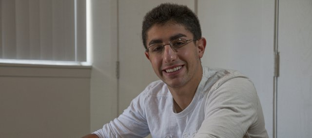 Jonathan Hurst-Sneh is a KU senior marketing major who will be getting ready for his finals during most of Hanukkah.