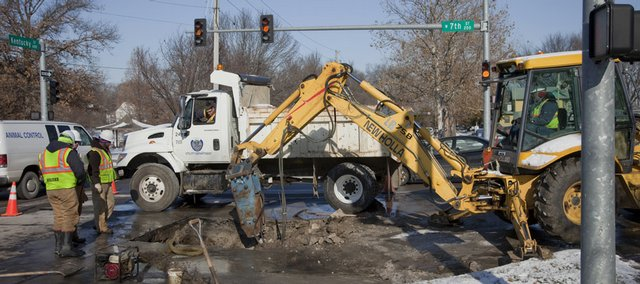 City crews work on a water main break at the intersection of Seventh and Kentucky streets, Friday, December, 11, 2009. The break caused the public library to shut down and two businesses to go without water.