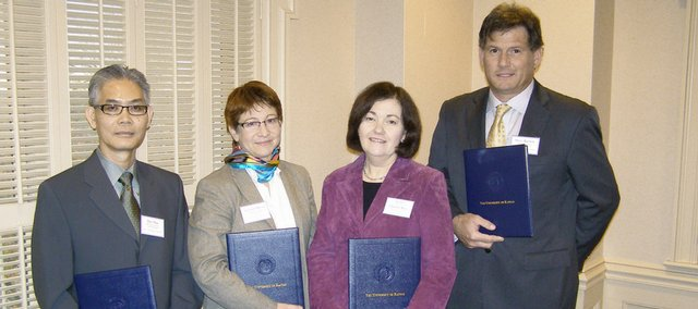 From left are the 2009 Higuchi award recipients: Duy Hua, Kansas State University; Arienne Dwyer, Kansas University; Sue Rice, standing in for her husband, Charles Rice, K-State; and Steven Barlow, KU.