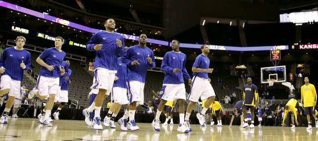 The Kansas Jayhawks trot across the Sprint Center court, warming up before taking on LaSalle, Saturday, Dec. 12, 2009.