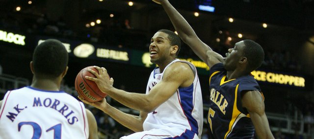 Kansas forward Xavier Henry elevates to the bucket past La Salle guard Kimmani Barrett during the first half, Saturday, Dec. 12, 2009 at the Sprint Center in Kansas City, Mo.