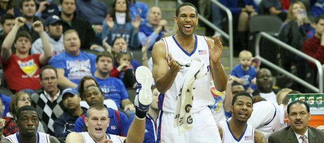 Kansas forward Xavier Henry stands up to applaud the play of his teammates along side Elijah Johnson, left, Cole Aldrich, Markieff Morris, assistant coach Kurtis Townsend and head coach Bill Self late in the second half, Saturday, Dec. 12, 2009 at the Sprint Center in Kansas City, Mo.