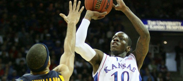 Kansas guard Tyshawn Taylor pulls up for a three over La Salle guard Terrell Williams during the first half, Saturday, Dec. 12, 2009 at the Sprint Center in Kansas City, Mo.