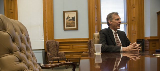 """Gov. Mark Parkinson talks with the Lawrence Journal-World about the state of the education budget Thursday. He says he will not approve any more cuts to higher education or public schools. """"The one thing that is not on the table is to cut education any more,"""" he said."""