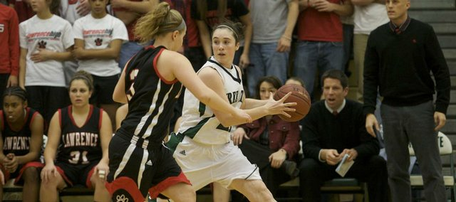 Free State's Wren Wiebe catches a pass under pressure from Lawrence's Cassie Potter during the game on Saturday, Dec. 19, 2009.