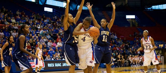 UC Riverside players Brittany Waddell (15) and Alyssa Morris (12) try double-teaming Kansas' Danielle McCray (4). It didn't work. McCray scored 30 points in the Jayhawks' 75-60 victory Sunday in Allen Fieldhouse.