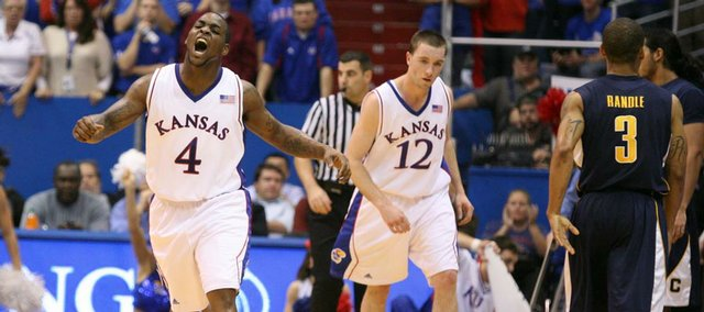 Kansas guard Sherron Collins roars after knocking down a bucket late in the second half to increase the Jayhawks' lead against California, Tuesday, Dec. 22, 2009 at Allen Fieldhouse.