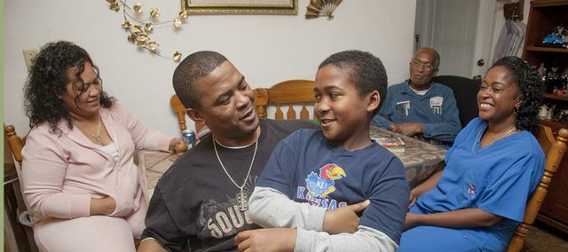 Sgt. Vernon Bell, a 1994 Lawrence High School grad, talks with his nephew, Tyler Bell, of Lawrence. Behind them, from left, are Maureen Bell, Loyce Bell and Priscilla Johnson.