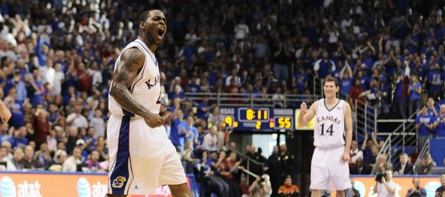 Kansas guard Sherron Collins pumps up the crowd after a dunk by teammate Cole Aldrich during the second half Saturday, Jan. 3, 2009 at Allen Fieldhouse.