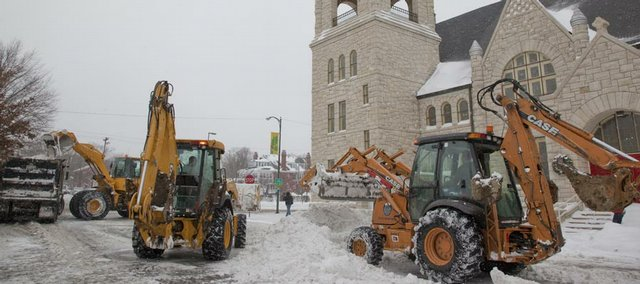 City crews used heavy equipment to remove snow near 10th and Vermont Saturday, Dec. 26, 2009. A several-day storm dumped more than 7 inches of snow on Lawrence.