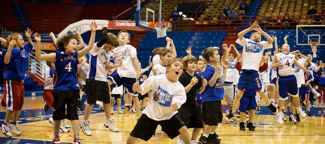 Campers practice shaking defenders off after pulling rebounds during the Winter Clinic on Sunday, Dec. 27, 2009, at Allen Fieldhouse.