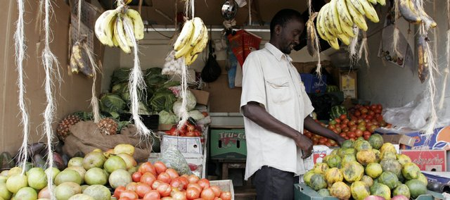 A roadside fruit vendor in Nairobi, Kenya, prepares his goods for sale on Tuesday, Dec. 29, 2009. John and Cindy Korb of Tonganoxie will leave next week for Kenya, where they will serve for 3 1/2 years doing mission work.