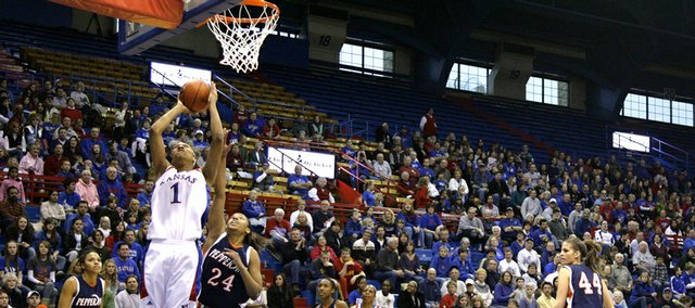 Kansas forward Aishah Sutherland goes up for a bucket over Pepperdine forward Keyah Shealy during the first half, Wednesday, Dec. 30, 2009 at Allen Fieldhouse.