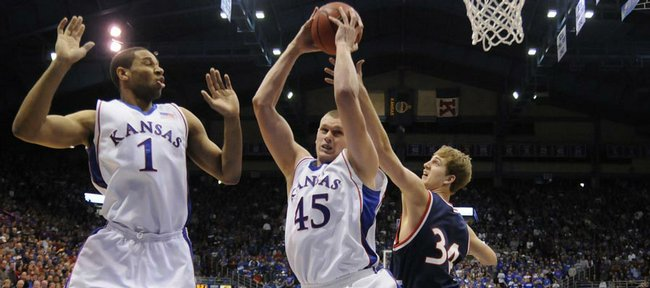 Kansas forward Xavier Henry backs off as center Cole Aldrich pulls a rebound away from Belmont forward Mitch Hedgepeth during the first half, Tuesday, Dec. 29, 2009 at Allen Fieldhouse.