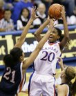 Kansas guard Sade Morris pulls up for a shot in the paint over Pepperdine forward Miranda Ayim during the first half, Wednesday, Dec. 30, 2009 at Allen Fieldhouse.